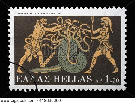 ZAGREB, CROATIA - SEPTEMBER 18, 2014: Stamp printed in Greece shows Hercules Deeds - Hercules and Lernean Hydra, circa 1970