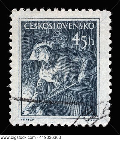 ZAGREB, CROATIA - SEPTEMBER 18, 2014: Stamp printed in Czechoslovakia shows Metallurgist, Professions series, circa 1954