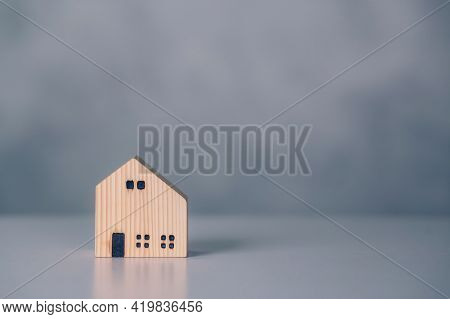 Mini Wooden Home Model Concept, Investment Of Real Estate And Asset, Tax Of Property And Rental For