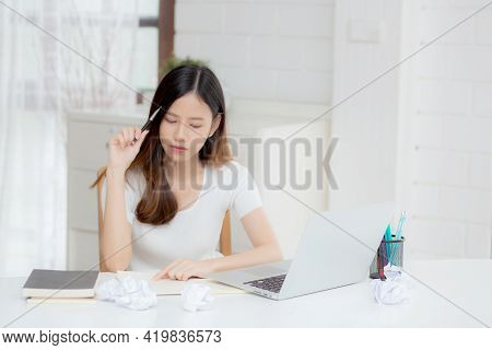Young Asian Woman Working With Laptop Computer Think Idea Project And Paper Crumpled Having Problem