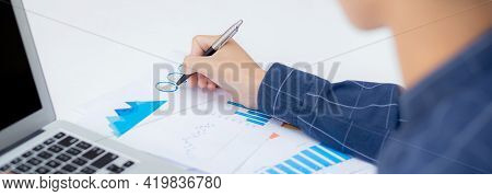 Young Asian Business Man Pointing Document Data Graph And Chart With Pen, Marketing And Investment,