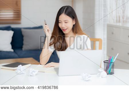 Young Asian Woman Confident Working At Home With Laptop Computer And Thinking Idea For Planning, Fre