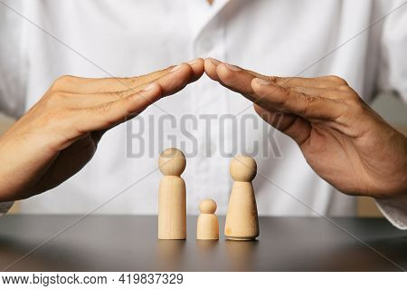 Protecting Hands Over  Family, Family Protection And Care Concept,insurance Concept