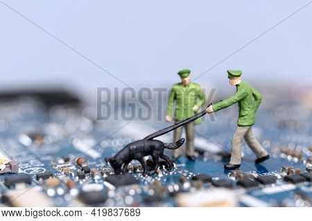Miniature People Police And Detective Are Working On A Computer Mainboard