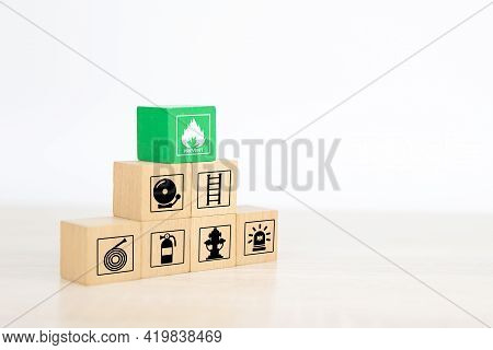 Fire, Cube Wooden Toy Block Stack In Pyramid With Prevent Icon With Fire Extinguisher And Emergency