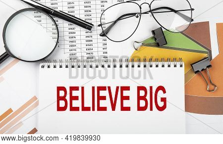 Text Believe Big On White Paper Notebook On The Diagram. Business