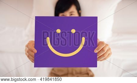 Happy Person Concept. Woman Lay On Bed Smiling And Show Smile Icon Face On Card. Customer Experience