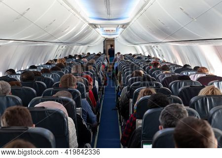 Russia Moscow 2021-03-01 Interior Of Large Airplane With Passengers People On Seats