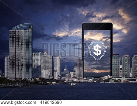 Dollar With Shield Flat Icon On Modern Smart Mobile Phone Screen Over Office City Tower, Skyscraper,