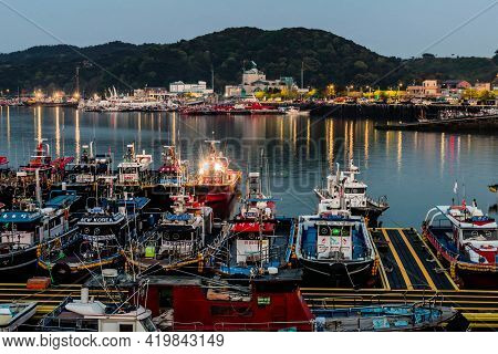 Daecheon, South Korea; April 25, 2021: Night View Of Fishing Trawlers Moored At Seaport Dock.