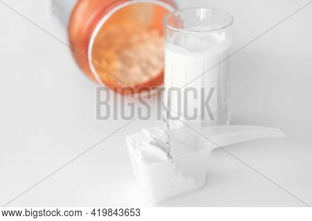 Scoop Of Whey Protein Or Collagen And Jar With Protein Powder. Supplement For Healthy Joints And Bea