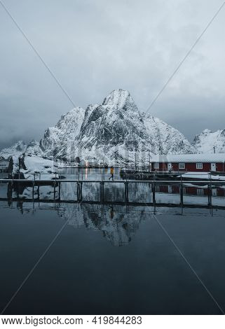 Red cabins on a snowy Reine in Moskenesøya island, Norway