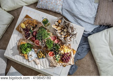 Top View Cosiness Lounge Interior With Serving Table Ready For Party Celebrating Hygge Boho Scandi