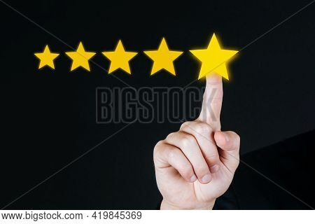 Excellent. 5 Star Rating. Business Customer Hand Pressing Five Star Button On Visual Screen To Revie
