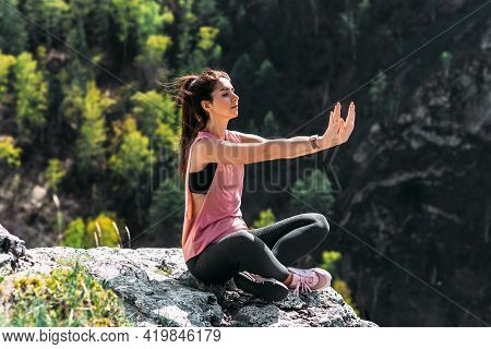 Attractive Woman Doing Yoga. Healthy Lifestyle. The Concentration Of The Body. Woman Doing Yoga In T