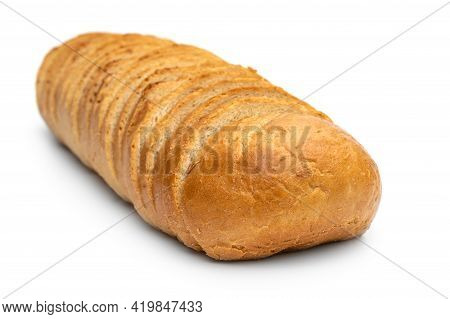 Sliced Loaf Of Bread On White Background.