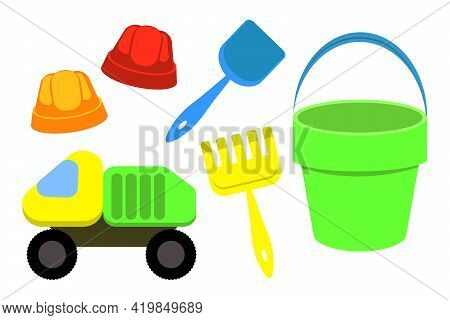 Children's Bucket, Shovel And Rake, Sand Moulds Isolated On A White Background. A Set Of Toys For Ch