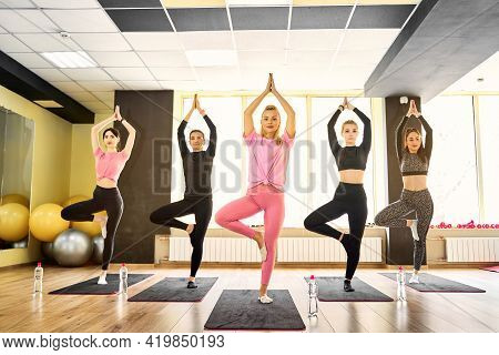 Yoga Practice Exercise Class, Group Of Sporty People Practicing Yoga Lesson At Indoor Studio, Standi