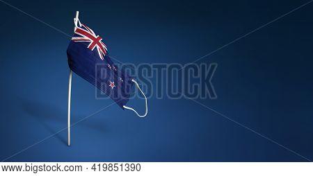 New Zealand Mask On Dark Blue Background. Waving Flag Of New Zealand Painted On Medical Mask On Pole