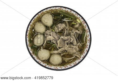 Beef Clear Soup With Sliced Beef, Meatball, Morning Glory And Bean Sprouts In Bowl Isolated On White