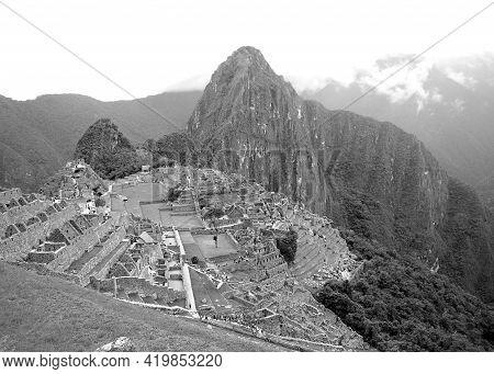 Monochrome Machu Picchu In The Cloudy Day, An Incredible Inca Citadel In Urubamba Province, Cusco Re