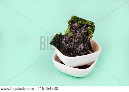 Crispy Nori Seaweed On Bowls. Traditional Japanese Dry Seaweed Sheets.
