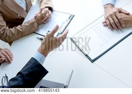 Businessmen Are Reaching A Hand Out For A Handshake To Congratulate Job Applicants Who Have Passed I