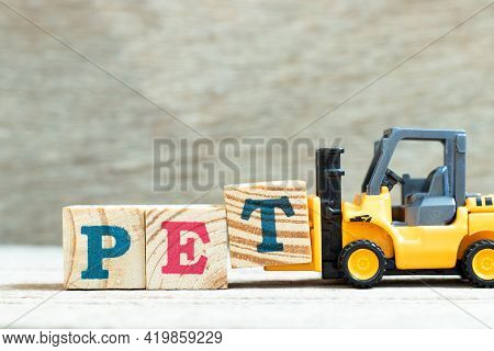 Toy Forklift Hold Letter Block T To Complete Word Pet (animal Or Abbreviation Of Polyethylene Tereph