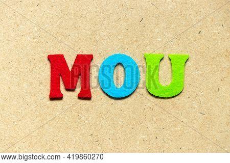 Color Cloth Alphabet Letter In Word Mou (abbreviation Of Memorandum Of Understanding) On Wood Backgr