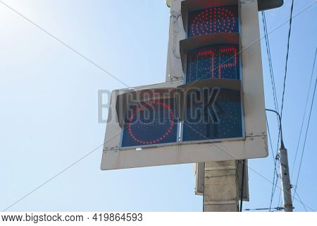 Traffic Light With A Dial And An Additional Section For Turning Against A Clear Sky Background. The