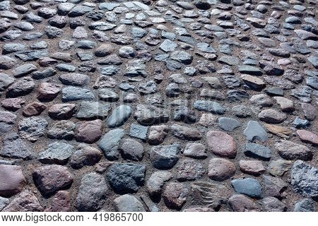 Old Cobblestone Pavement.  City Street Cobbled With Large Stones