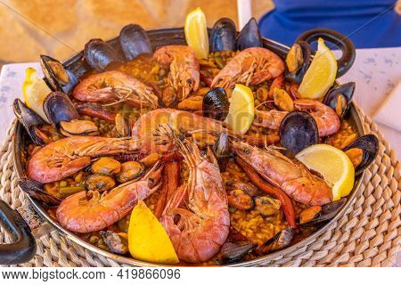 Close-up Of A Seafood Paella Preparation. Paella Ready To Serve