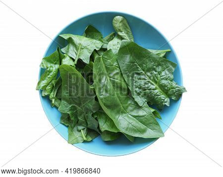 Green Spinach Leaves In A Dish Isolated Over White