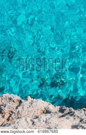 Clear Turquoise Ocean Water, Tropical Vibe, Mediterranean Sea, Mallorca, Spain. White Cliff Stone