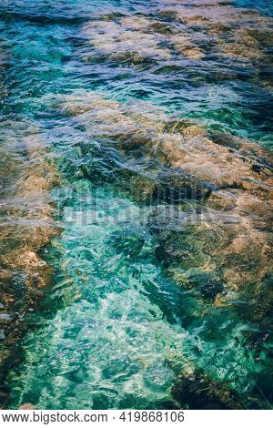 Background Of Transparent Sea Water And Bottom. Crystal Clear Turquoise Ocean Water, Mediterranean S