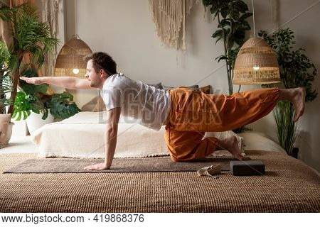 Man Practices Yoga Asana Marjariasana Or Cow Pose Or Cat Cow Pose For Spine
