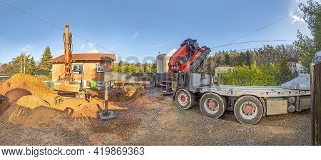 Construction Site With Digger And Lorry To Place A Sewage Pit In Panoramic View