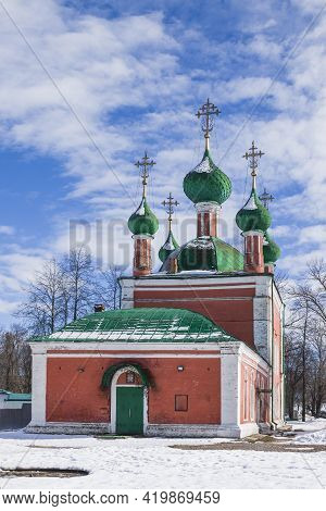 Gold Dome Of A Rural Church In Russia With A Cross On The Background Of The Spring Sky. Cross On The