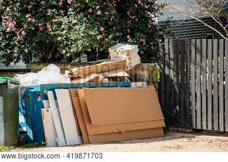 Household Miscellaneous Rubbish Items Piled Outside The Residential Building On Kerbside For Council