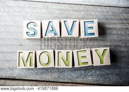 Save Money Written On Wooden Blocks On A Board