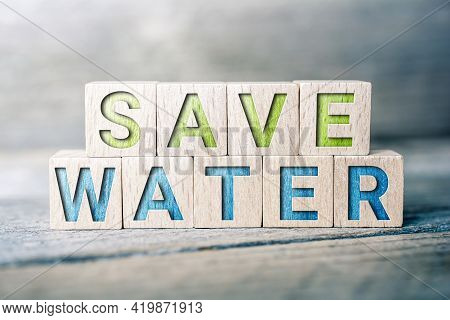 Save Water Written On Wooden Blocks On A Board - Climate Change Concept