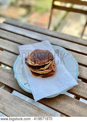 Almond Flour Made Paleo Pancakes Served With Hand In Plate.