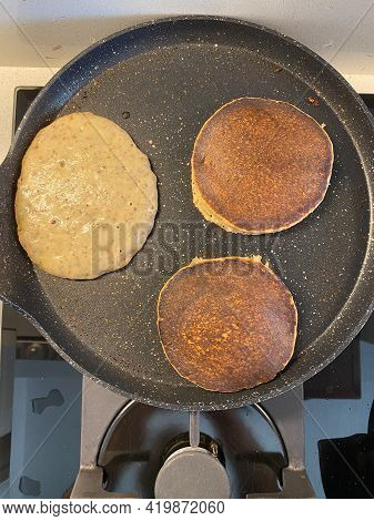 Cooking Paleo Pancakes With Almond Flour In Pan.