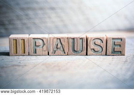 Pause Written On Wooden Blocks On A Board