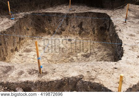 Archaeological Work, Archaeologists Dug A Hole In Field To Search For Historical Artifacts And Finds