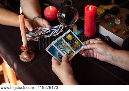 Seance Of Fortune Telling On A Tarot Cards, Candles And Fortune-telling Objects. The Concept Of Divi