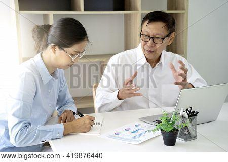 A Businessman Mentor And Intern  Woman Staff