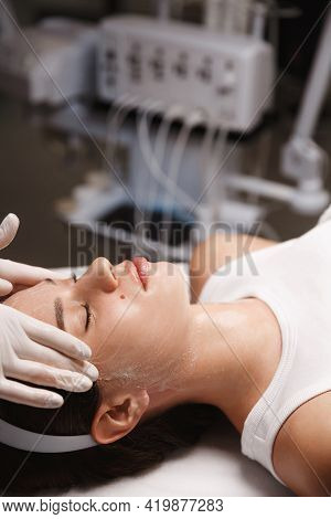 Skin Care Treatment And Cosmetology. Close Up Of Woman At Spa Salon, Cosmetic Clinic, Beautician Doc