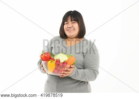 Fat Asian Woman Holding A Bowl Of Fresh Organic Vegetables Food For Good Health. The Concept Of Losi