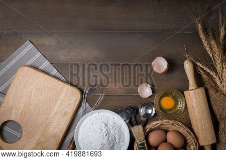 Bread Flour With Fresh Egg And Accessories Bakery On Wood Background, Prepare For Homemade Bakery Co